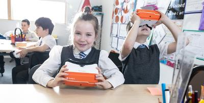 Pupils using VR headsets