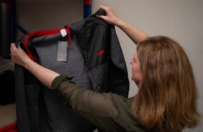Trading standards officer holding counterfeit item